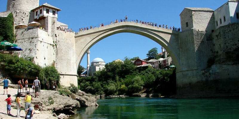 Old Bridge - a prominent medieval stone bridge, which connects the coasts of Herzegovina pearl - Neretva River.